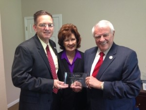 Jim Reed (left) presenting NADO Award to Congressman Carter (right)